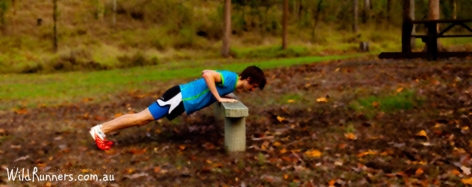 Push up using a bench. Core Exercises for runners with Wild Runners